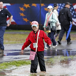 A girl plays in floodwater after play is suspended due to heavy rainfall on the first day of the 2010 Ryder Cup.