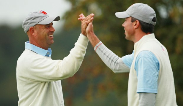 Stewart Cink high-fives Matt Kuchar during the opening four-ball matches.