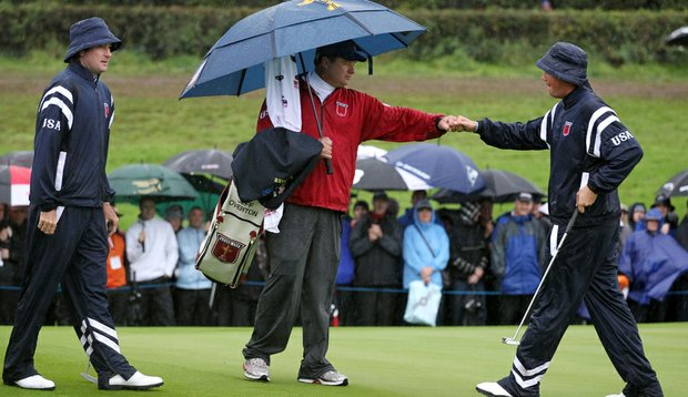 Bubba Watson and Jeff Overton celebrate after birdieing the first hole at Celtic Manor.