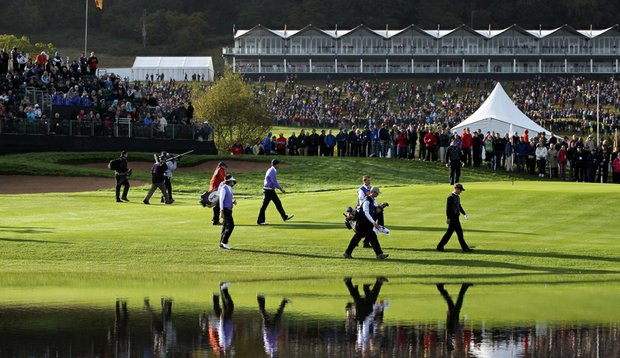 Luke Donald and Padraig Harrington of Europe are seen walking with Bubba Watson and Jeff Overton of the USA during the rescheduled morning four-ball matches during the 2010 Ryder Cup.