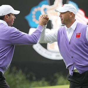 Stewart Cink celebrates with Matt Kuchar (L) during the rescheduled afternoon foursome matches during the 2010 Ryder Cup.