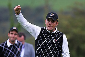 Francesco Molinari of Europe celebrates a birdie putt on the third green during the four-ball and foursomes matches during the 2010 Ryder Cup.