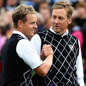 Luke Donald (L) and Ian Poulter of Europe celebrate winning their match on the 17th green during the rescheduled afternoon foursome matches.