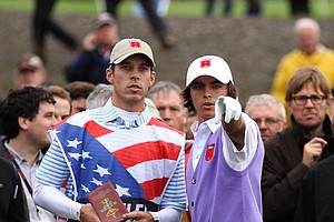 Rickie Fowler gestures to his caddie Joe Skovron during the four-ball and foursome matches.