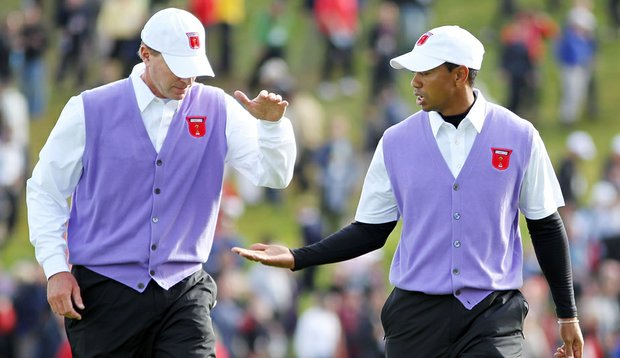 Steve Stricker and Tiger Woods won their match over Luke Donald and Padraig Harrington, 3 and 2.