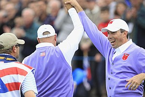 Matt Kuchar and Stewart Cink celebrate at the 17th.
