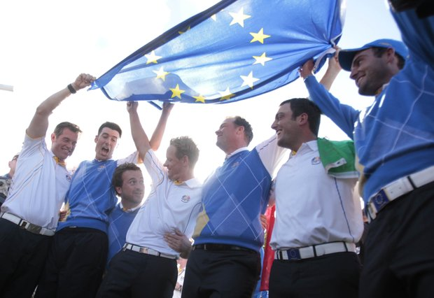 Members of the European team celebrate after winning the Ryder Cup.