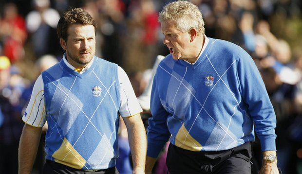 European captain Colin Montgomerie (right) approaches the 17th tee with Graeme McDowell at the Ryder Cup.