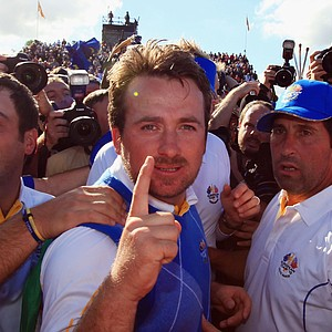 Graeme McDowell celebrates with teammates after clinching the Ryder Cup.