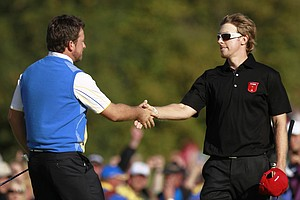 Graeme McDowll (left) and Hunter Mahan shake hands after Europe won the Ryder Cup.