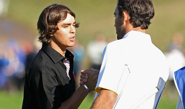 Rickie Fowler shakes hands with Edoardo Molinari on the 18th green after the pair halved their singles match at the Ryder Cup.