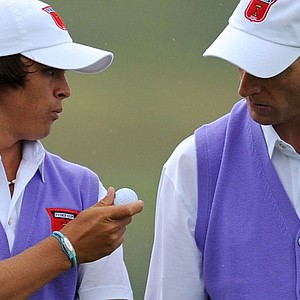 Rickie Fowler (left) speaks with partner Jim Furyk during the opening session of foursomes on the second day of the Ryder Cup.