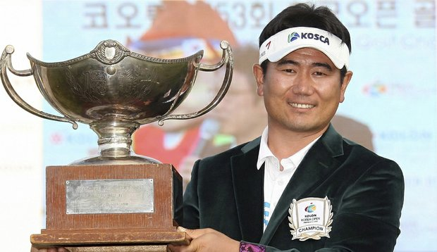 Y.E. Yang holds up his trophy after winning Korea Open at Woo Jeong Hills Country Club in Cheonan, South Korea.