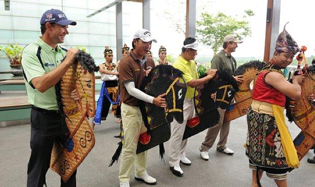 Padraig Harrington, Danny Chia, KJ Choi and Retief Goosen practice the Kuda Kepang traditional dance before the Iskandar Johor Open.