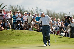 Ernie Els acknowledges the crowd after rolling in a putt on the fifth hole Tuesday at the PGA Grand Slam of Golf.