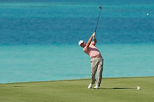 Graeme McDowell tees off on the ninth hole during Round 1 of the PGA Grand Slam of Golf.