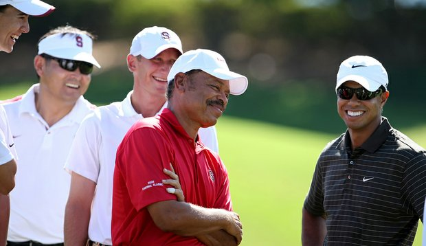 Tiger Woods, right, shares a laugh with Stanford players and Isleworth member Stephen Brooks during the 2009 Isleworth Collegiate.