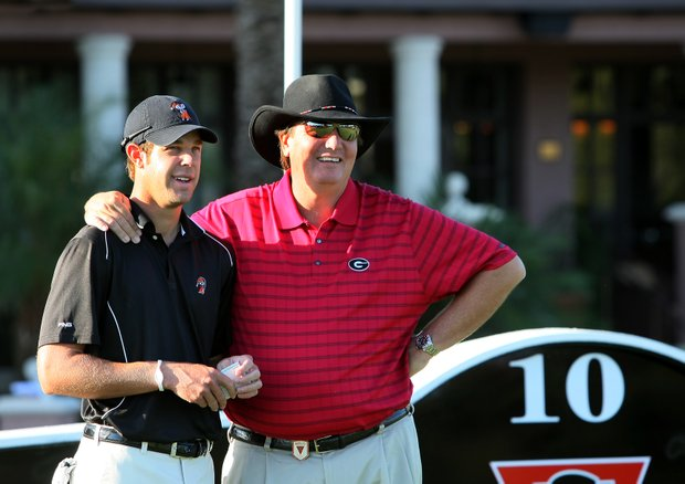 Oklahoma State's Kevin Tway, left, and University of Georgia'a head coach Chris Haack, right, at No. 10 tee on Sunday.