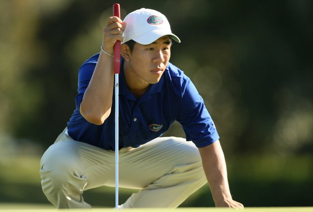 University of Florida's Bank Vongvanij gets low to read a putt on Monday.
