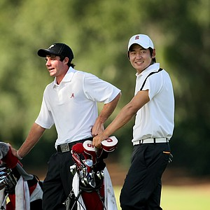 Stanford's Andrew Yun and Alabama's Hunter Hamrick wait at No. 2, a par-3 on Monday.