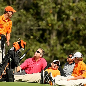 Kevin Tway talks with the rest of his Oklahoma State team at Isleworth.