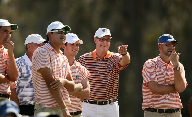 Florida coach Buddy Alexander points to Bank Vongvanij at No. 18. Vongvanij took individual honors at the ICI.