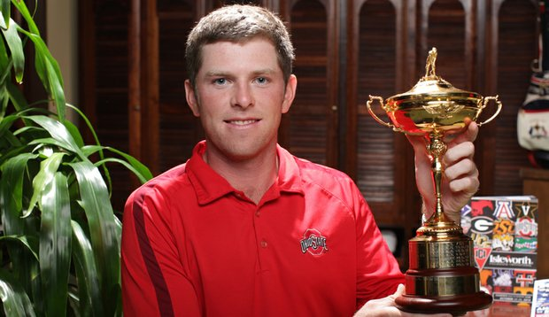 Ohio State's Bo Hoag holds the Ryder Cup after the players dinner at the Isleworth Collegiate.