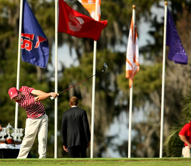 Team flags are on display at Isleworth Collegiate as Alabama's Hunter Hamrick tees off at No. 1.
