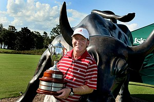 Jay Seawell holds the team trophy from the Isleworth Collegiate.