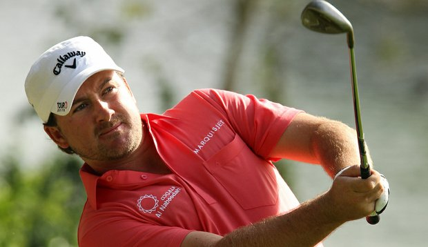 Graeme McDowell pitches to the 10th green during the third round of the 2010 Andalucia Valderrama Masters.