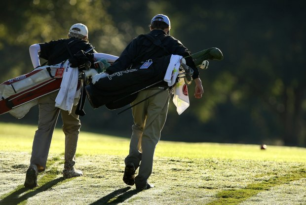 C.J. Wagner, left, and Blake Hadden, right, walk down the 4th tee in the morning dew.