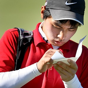 Sam Chun finishes his scorecard at No. 18. Chun came from behind to win on Sunday.