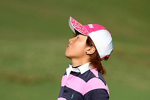 Ri Hyang Park reacts after her round, she came in second, six shots behind the leader, Doris Chen.