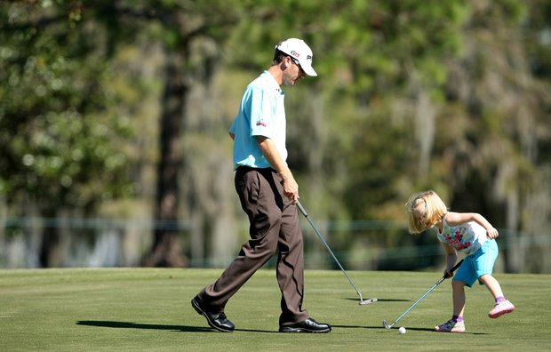 Rose Riley, 4, with her dad, PGA Tour player, Chris Riley at the 9th hole.