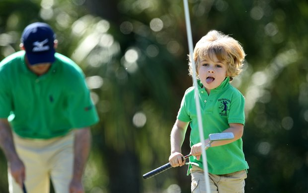 Jackson Byrd, 4, son of Jonathan Byrd, runs toward the pin at the third hole during Wednesday's Father/Child tournament.