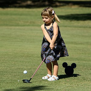 Addison Curtis, 2, daughter of Ben Curtis hits her tee shot at No. 8. Curtis' son Liam also played.