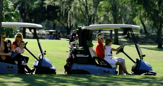 Brian Gay and his family cruise between holes at the Father/Child tournament.