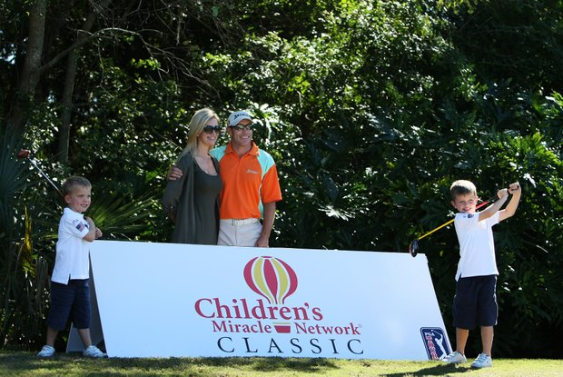 Brian Davis, center, with his wife, Julie and chidren, Henry, 4, left, and Oliver, 6, right, at the Father/Child tournament.