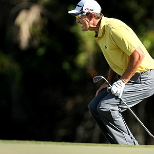 Greg Owen just misses his birdie putt at No. 18.