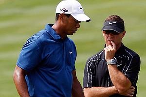 Sean Foley talks with Tiger Woods at the 2010 PGA Championship.