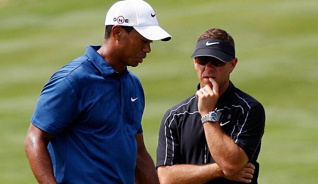 Sean Foley talks with Tiger Woods at the 2010 PGA Championship.