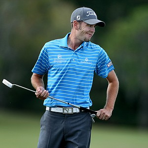 Troy Merritt reacts to missing his birdie putt at No. 17, the Kodak Challenge hole.