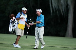 Joe Durant shares a laugh with his caddie at No. 18. Durant is currently 120 on the money list.