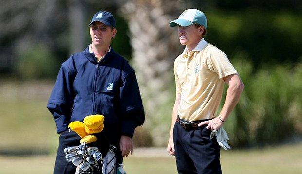 Matt Clark, left, talks with player Taylor Zimmerman during the 2009 John Hayt Collegiate Invitational.