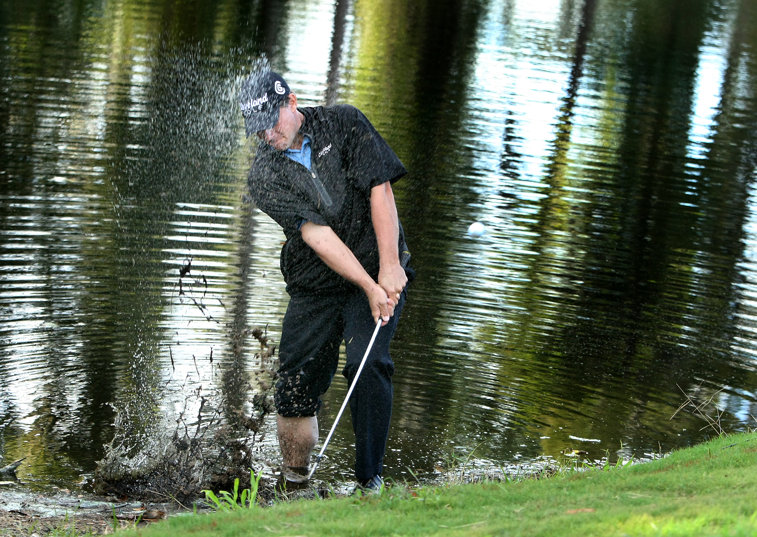Roland Thatcher hits out of the hazard at No. 17.