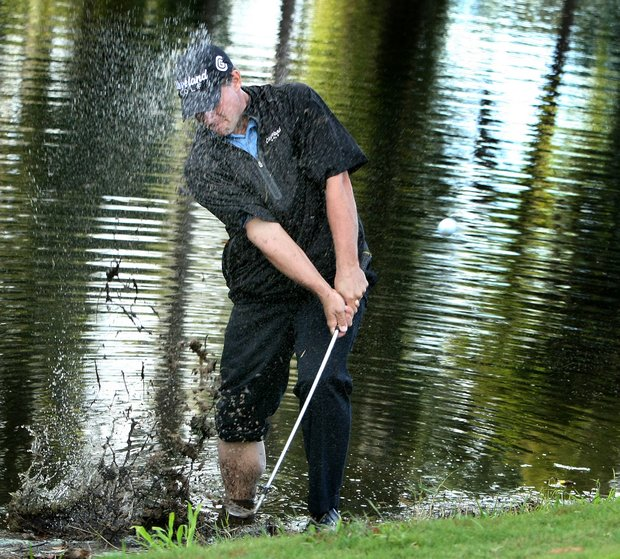 Roland Thatcher hits out of the hazard at No. 17 during the third round at the Children's Miracle Network Classic.