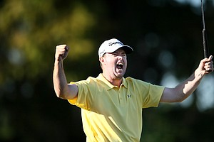 Robert Garrigus celebrates winning with a two stroke lead.