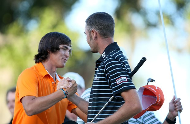 Rickie Fowler congratulates Troy Merritt after he won the Kodak Challenge in a playoff at No. 17.