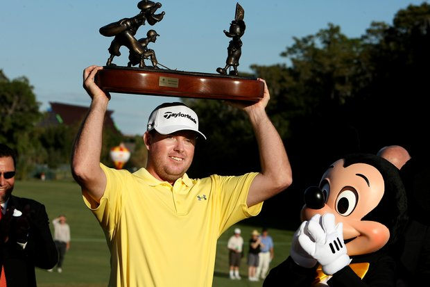 Robert Garrigus hoists the trophy after winning the Children's Miracle Network Classic.