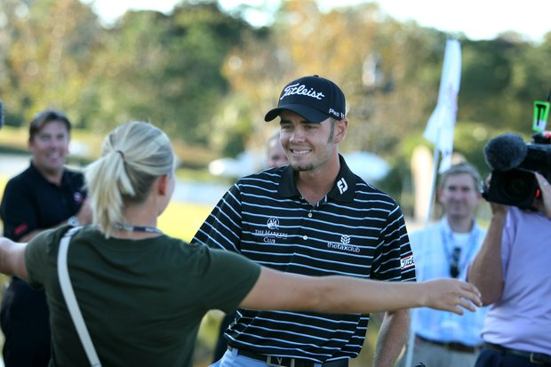 Troy Merritt gets a hug from his wife, Courtney, after winning the Kodak Challenge.